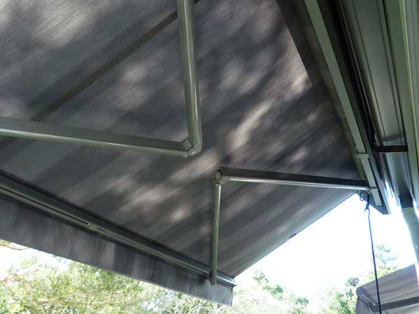 Folding arm fabric awning