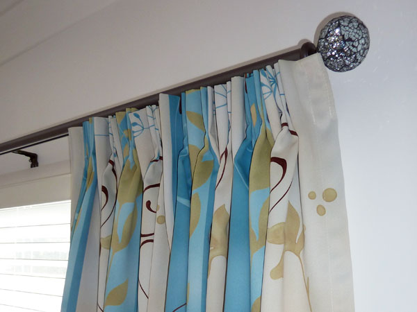 curtain on black rod slider with dazzle ball finial